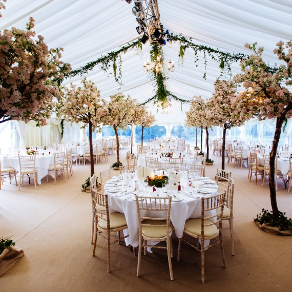 Beautiful elegant wedding trees in marquee Ardington House Oxfordshire