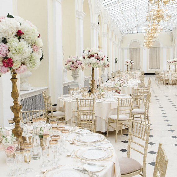 Hydrangeas and roses decorating gold candelabra Blenheim Palace - Beautiful bespoke arrangements with gorgeous fabulous wedding flowers by Joanna Carter Wedding Flowers Oxford Oxfordshire Buckinghamshire Berkshire London