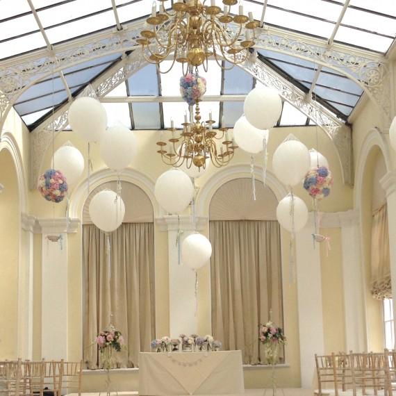 A balloon filled Orangery at Blenheim Palace - Beautiful bespoke arrangements with gorgeous / fabulous wedding flowers by Joanna Carter Wedding Flowers Oxford Oxfordshire Buckinghamshire Berkshire London