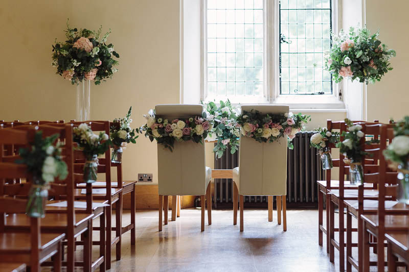 Beautiful Elegant chair back wedding flowers Notley Abbey, Buckinghamshire, Joanna Carter Wedding Flowers Oxfordshire Buckinghamshire Berkshire London
