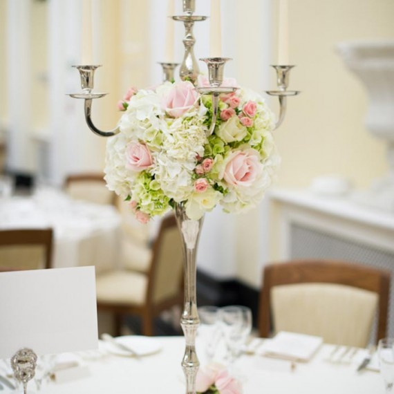 Candelabra decorated with roses and hydrangeas in the Orangery at Blenheim Palace, Oxfordshire