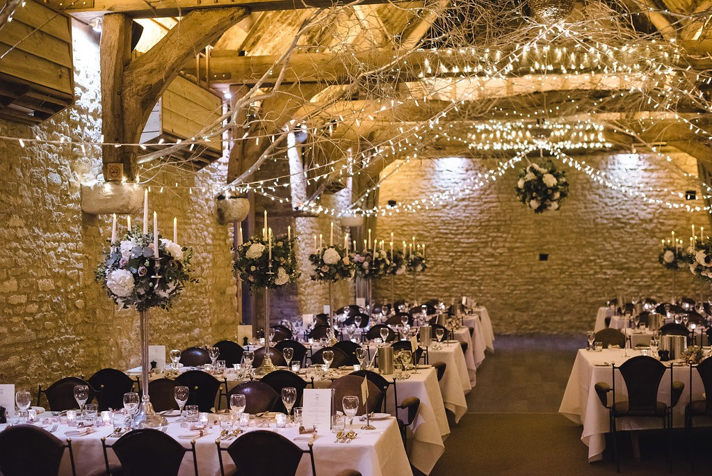 Reception Candelabra Flowers, Launton Tythe Barn. Joanna Carter Wedding Flowers, Oxford, Oxfordshire, Buckinghamshire, Berkshire and London